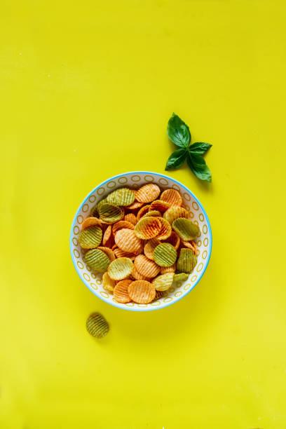 Veggie chips in bowl stock photo