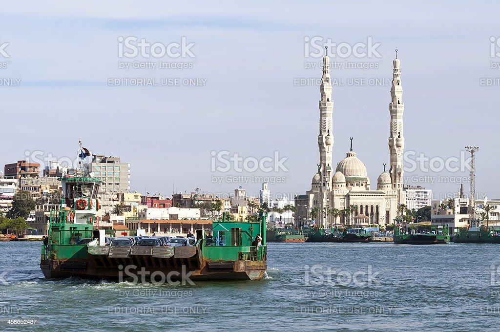 Suez Canal ferry and mosque stock photo