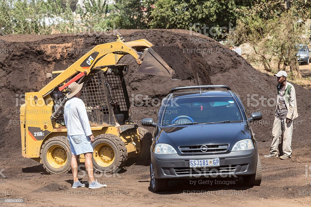 Vehicle being loaded with topsoil, compost royalty-free stock photo