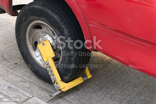 Seattle, USA - May 22, 2016: A vehicle boot on a clamped truck tire along the waterfront late in the day.