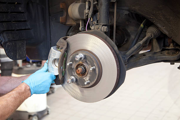 vehicle brake caliper service - brake service stock photos and pictures