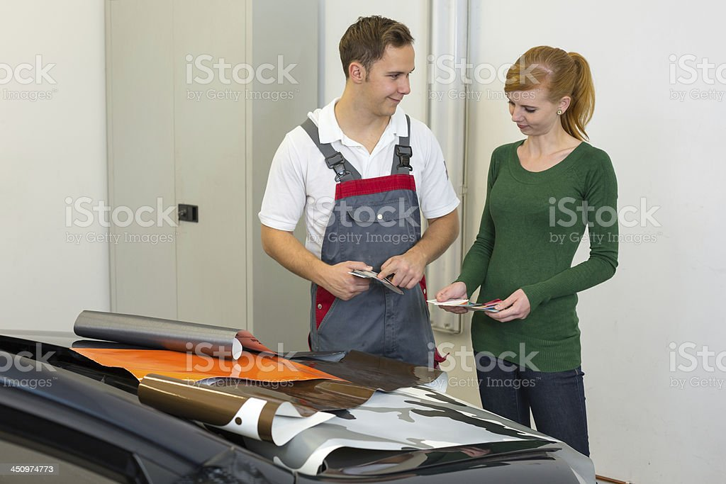 Vehicle Branding Specialist Consults Client About Adhesive Car Wrapping Foils Stock Photo Download Image Now Istock