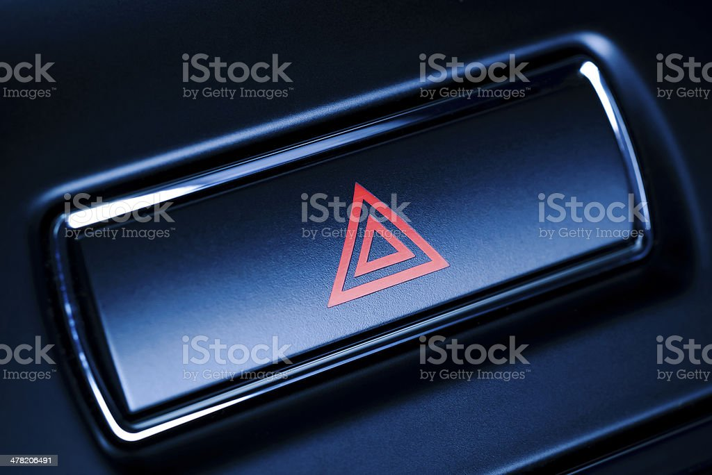 Vehicle, car hazard warning flashers button with visible red triangle. stock photo