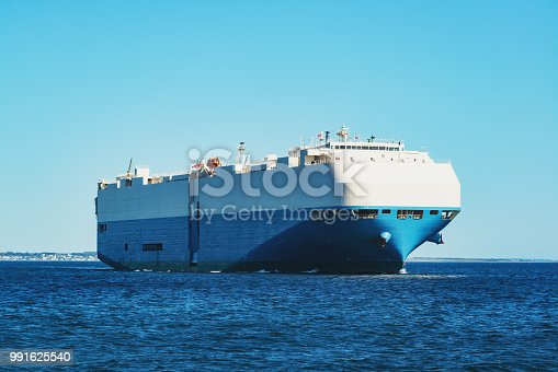 A vehicle carrier ship departs Halifax harbor.
