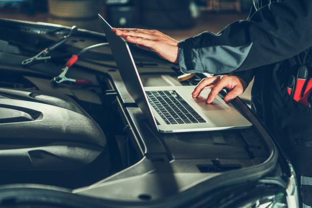 Vehicle Computer Checkup Vehicle Computer Checkup and Engine Software Update by Professional Auto Service Technician. Computerized Automotive Systems. auto mechanic stock pictures, royalty-free photos & images