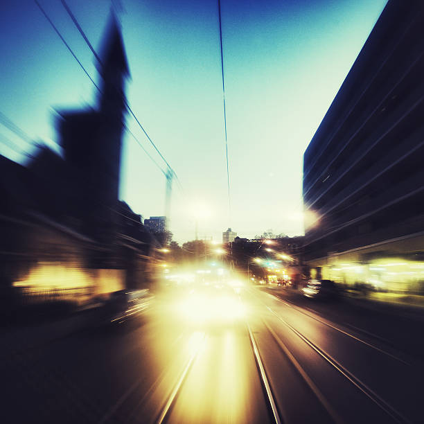 Vehicle in motion Long exposure in a moving vehicle, looking backwards at other vehicles, motion blur dazzled stock pictures, royalty-free photos & images