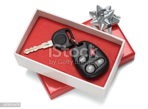istock Vehicle keys in white and red gift box with silver bow 157524470
