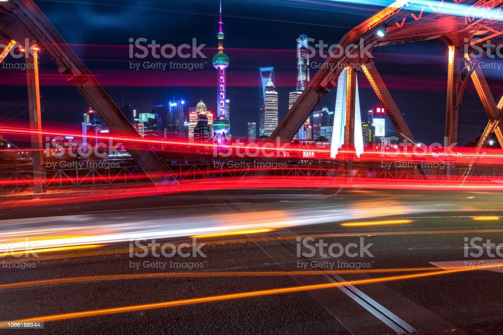Vehicle light trails at WaiBaiDu bridge stock photo