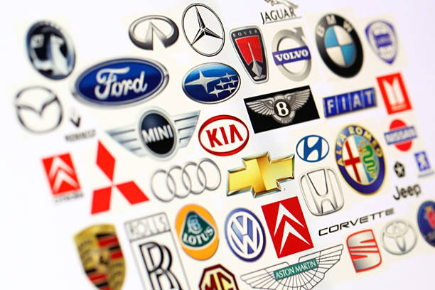 vehicle manufacturer logos - badge logo stock pictures, royalty-free photos & images