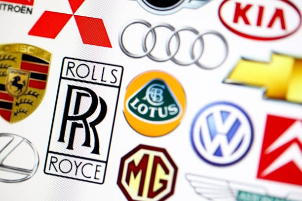 vehicle manufacturer logos - badge logo stock photos and pictures