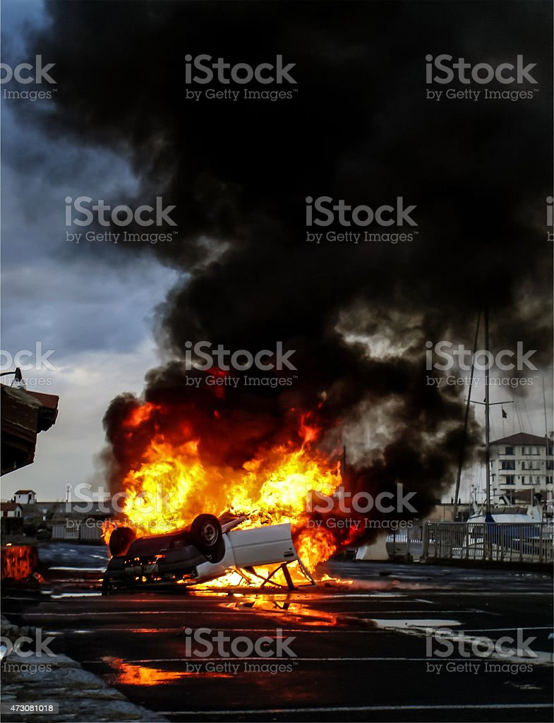 Vehicle overturned in flames stock photo