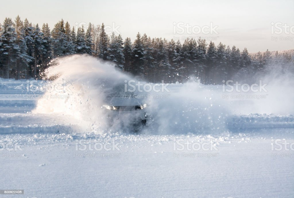 A vehicle sliding into deep snow causing an explosion effect stock photo
