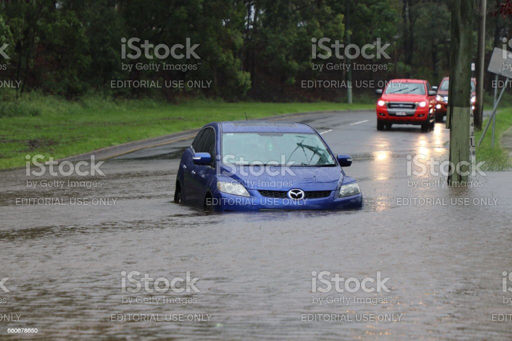 Vehicle stranded in floodwaters stock photo