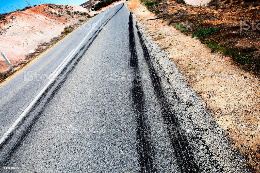 Vehicle tire brake skidmarks on rural asphalt road stock photo
