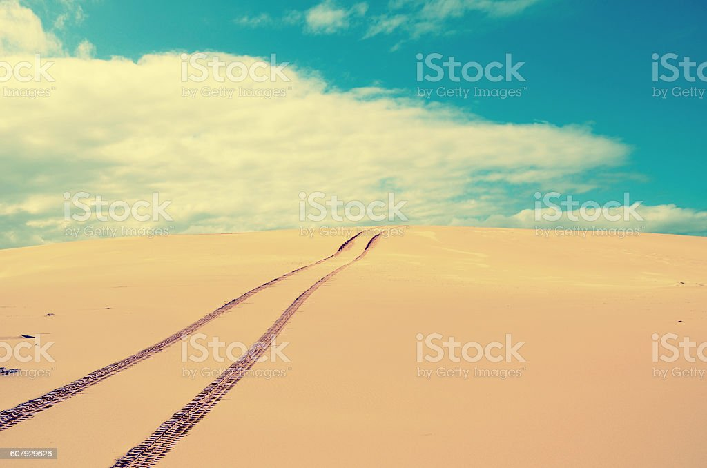 Vehicle tracks over a remote, deserted sand dune stock photo