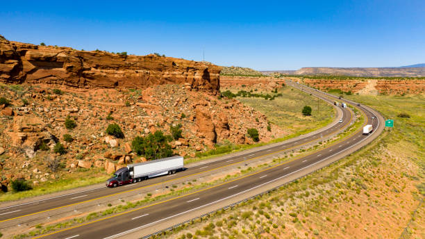 Vehicle Traffic moves along a Divided Highway in southwestern Desert Country stock photo