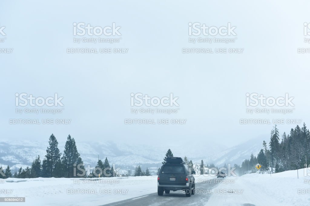 Vehicle traveling on Snow Covered Road stock photo