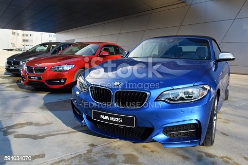 Munich, Germany - March 16th, 2016: The presentation of three differents BMW 2-series vehicles (cabriolet, coupe and minivan) on the exposition. The BMW is one of the most popular premium vehicles brands in the world.