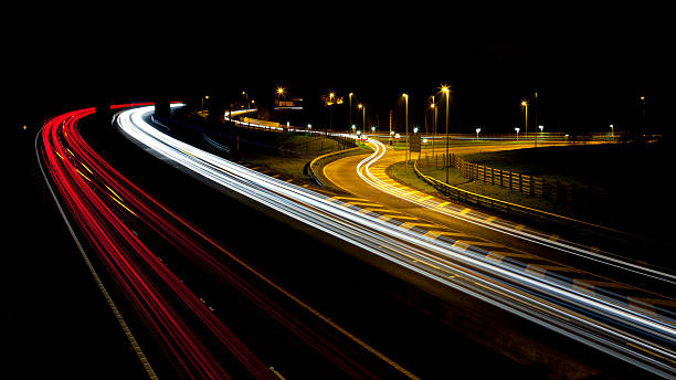 Vehicles on a motorway at night. stock photo