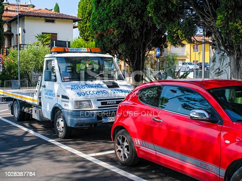 Verona, Italy - August 8, 2018: vehicles on a parking on a street in a center of Verona, Italy