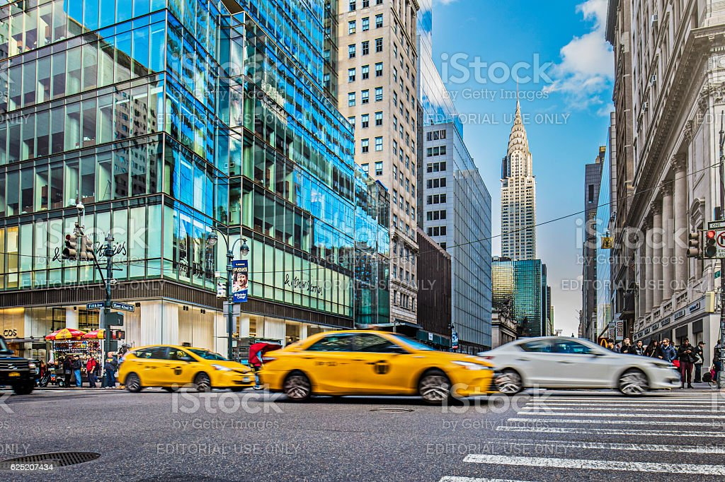 Vehicles on city street by Chrysler building stock photo