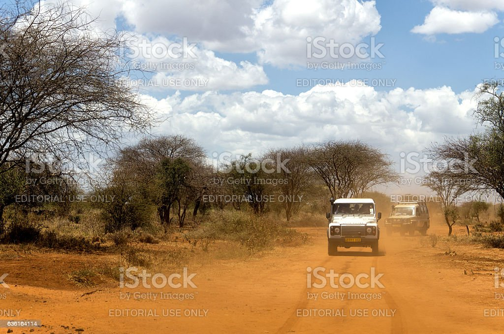 Vehicles on Dusty Road in Africa - foto de stock