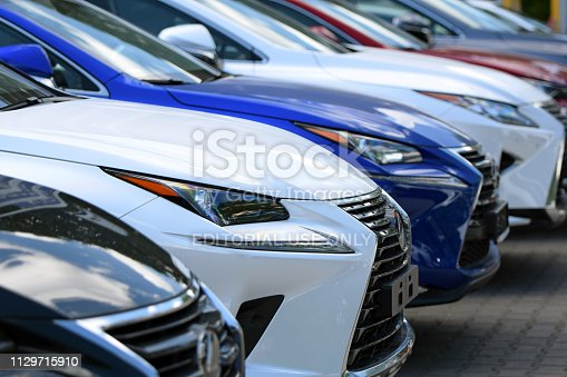133277230 istock photo SUV vehicles on the parking in a row 1129715910