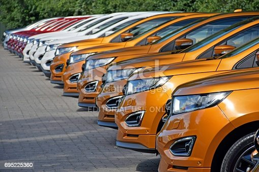 133277230 istock photo SUV vehicles on the parking 695225360