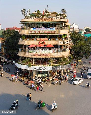 Hanoi, Vietnam - Jan 1, 2015: Vehicles running on a busy street near Hoan Kiem lake (Sword lake) in Hanoi capital, Vietnam. This area is the center of Hanoi.