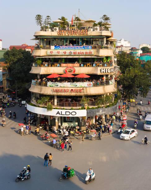 hanoi, vietnam - jan 1, 2015: vehicles running on a busy street near hoan kiem lake (sword lake) in hanoi capital, vietnam. this area is the center of hanoi - food logo stock photos and pictures