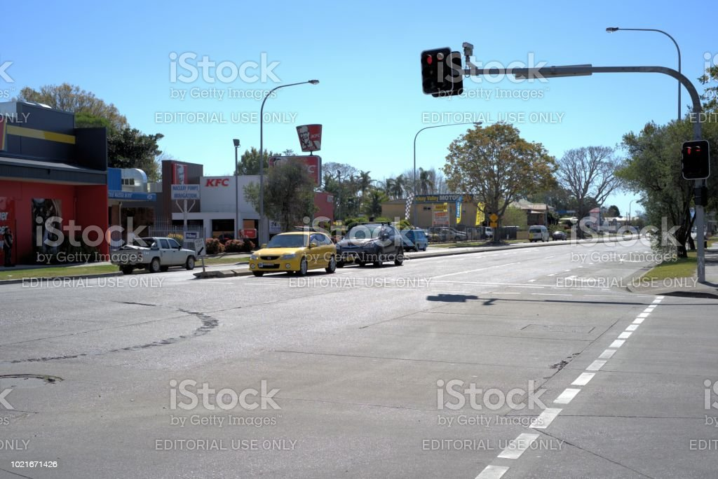 Vehicles waiting at traffic intersection in Australia stock photo