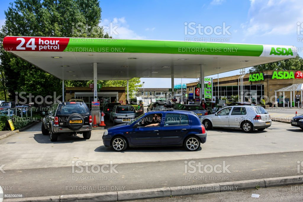 Vehicles waiting to fill up their vehicles at a gasoline filling station in Yeovil, Somerset UK stock photo