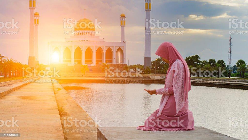 Veiled Islamic woman wearing a burka standing stock photo