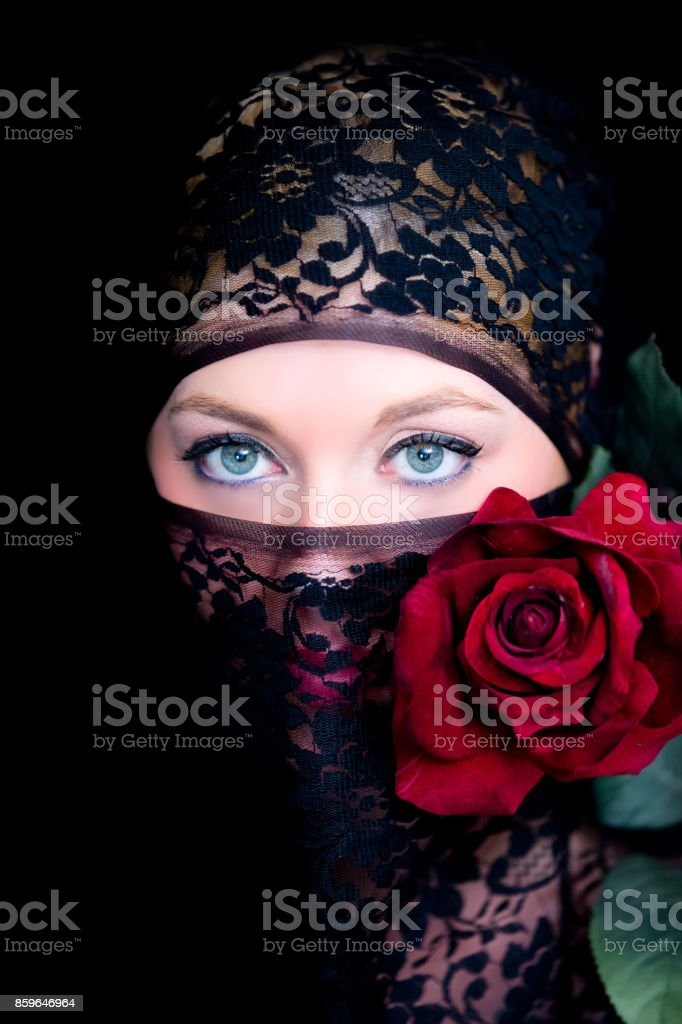 Veiled woman with blue eyes stock photo