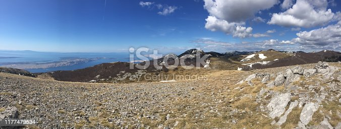 Panorama showing mountain peaks in the Northern Velebit National Park, Croatia. UNESCO World Heritage Site. The Northern Velebit National Park is recognizable by its preserved biodiversity, richness of the natural phenomena and experience of pristine wilderness.