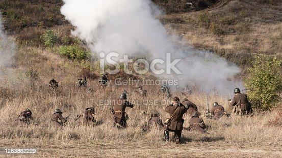 Veliko Tarnovo, Bulgaria - October 17, 2020:Actors depicting Nish operation. Re-enactors dressed as World War II Bulgarian soldiers walks on forest road.