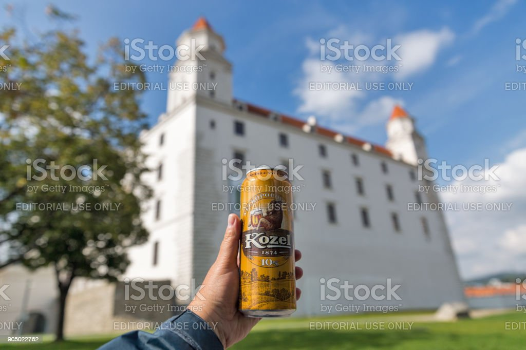 Velkopopovicky Kozel beer and medieval Castle in Bratislava, Slovakia. stock photo