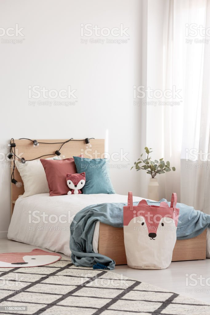 Velvet Pastel Pink And Turquoise Pillows And Toy Fox On ...