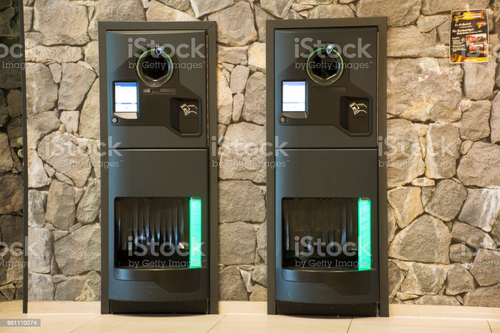 Vending Machine and receive money from machinery at supermarket stock photo