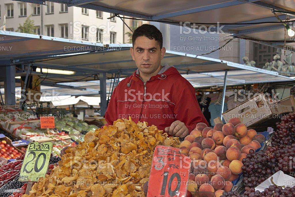 Vendor at Fruit Stand, Hotorget (Hay Market), Stockholm, Sweden royalty-free stock photo