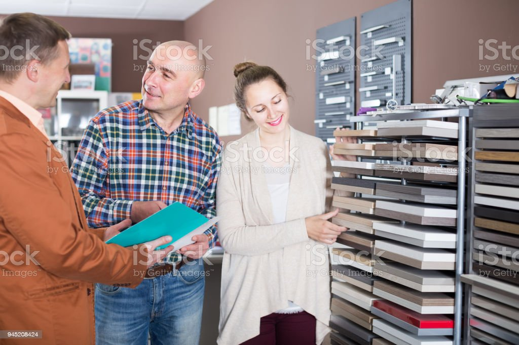 Vendor helps buyers choose furniture stock photo