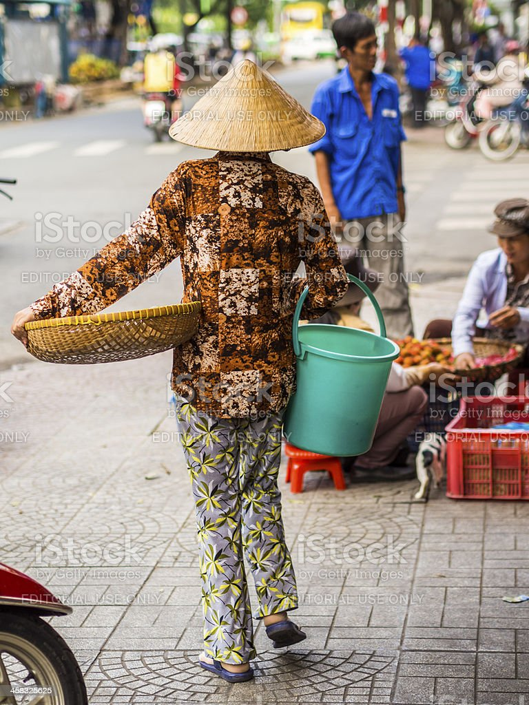 Vendor in a conical hat, Ho Chi Minh City, Vietnam royalty-free stock photo