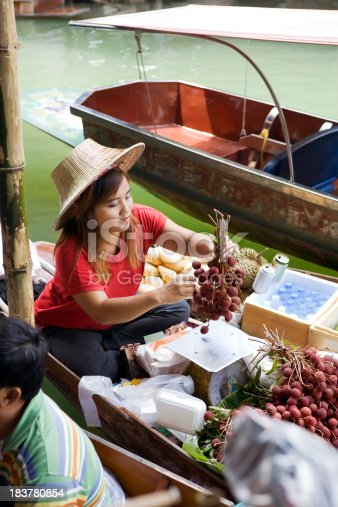 female food vendor in the floating market in Bangkok ThailandPeople and Business images