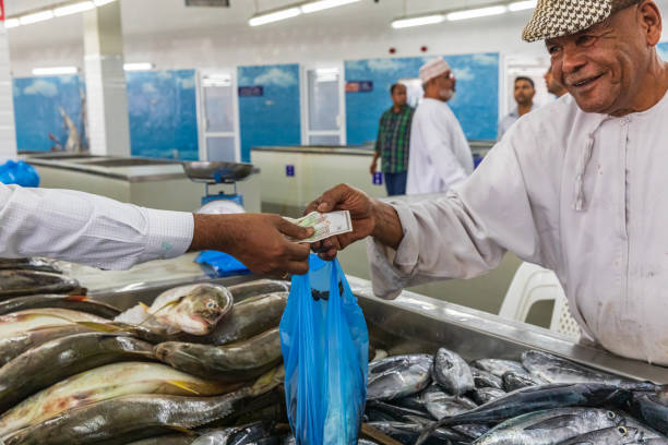 Vendor selling fish at the souk in Muttrah. stock photo