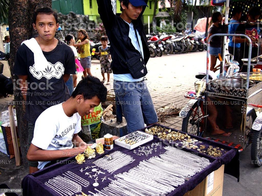A vendor sells assorted custom made fashion accessories stock photo