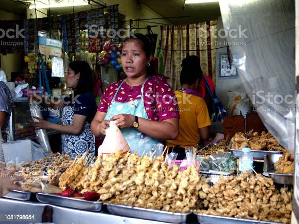 Vendor sells assorted fried street food in her food stall picture id1081798654?b=1&k=6&m=1081798654&s=612x612&h=olvxrmrbbifj vm9ih rjfkhrbr0qsxsiohzouuh0gu=