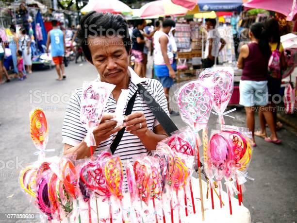 Vendor sells assorted lollipops and candies during the town fiesta picture id1077858680?b=1&k=6&m=1077858680&s=612x612&h=0irwmonmfvelfgphbc3jxf dtadxtxtiqmw tjpg6os=