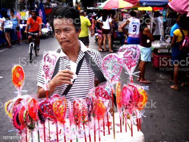 Vendor sells assorted lollipops and candies during the town fiesta picture id1077877118?b=1&k=6&m=1077877118&s=612x612&h=hmd7mvm3bohlniis8djrnnjoflaz4sx5 auguzez5pa=