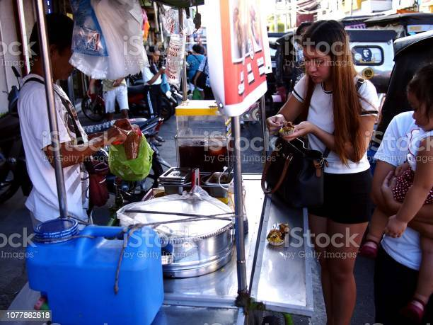 Vendor sells assorted street food in his food cart during the town picture id1077862618?b=1&k=6&m=1077862618&s=612x612&h=xmm9hpgwmysurtp4x5vah9jw0 wtx1ypz2lxpryp2wg=