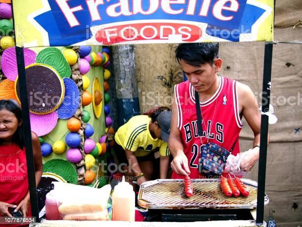 Vendor sells assorted street food in his food cart during the town picture id1077876534?b=1&k=6&m=1077876534&s=612x612&h=j8ah7poe1 u4ptjiazcjxhva8m1g9numjxboqee sue=